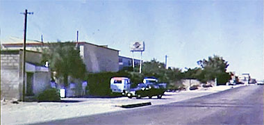 Looking north along Airport Road with the Pepsi factory on the left, 1968 – image developed from a video with permission from glasney on YouTube