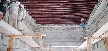 Workmen repairing the first floor room of Sheikh Abdullah's majlis