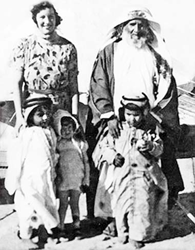 Said to be Sheikh Abdullah bin Jassim al Thani with his grandchildren, from the right, Sheikh Jassim bin Hamad and Sheikh Khalifa bin Hamad, and Mrs Dickson, wife of the British Resident in Kuwait, photographed in Qatar