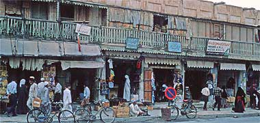 A view of buildings on the west side of Suq Waqf street in March 1972