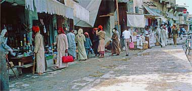 A view of shops on the west side of Suq Waqf street in March 1972